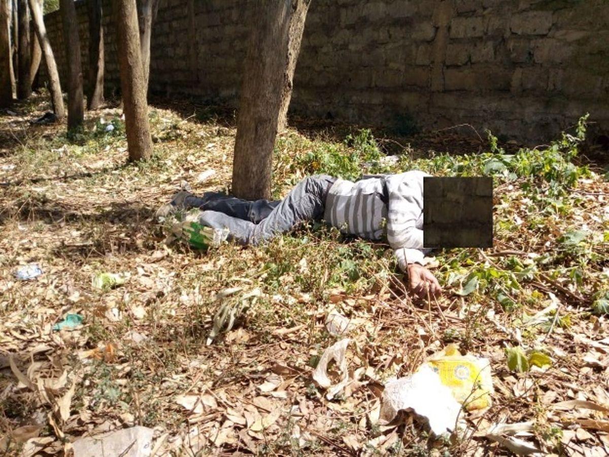 Man found dead, body dumped outside school