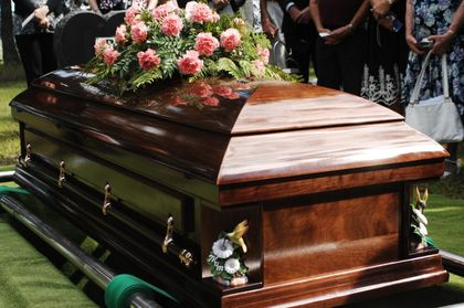 Man crushed to death by casket during mother's funeral